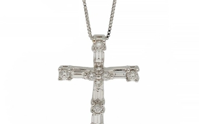 A diamond pendant in the shape of a cross set with numerous baguette and brilliant-cut diamonds, mounted in 18k white gold. Accompanied by necklace.
