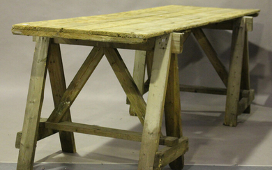 A large early/mid-20th century pine trestle table, the five-plank top on a pair of 'A' fra