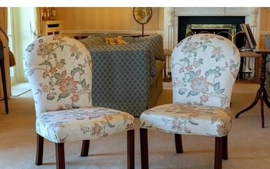 A pair of 18th century mahogany upholstered chairs, the ball...