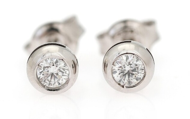 NOT SOLD. A pair of diamond ear studs each set with a brilliant-cut diamond weighing...