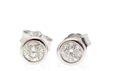 A pair of diamond solitaire ear studs each set with a brilliant-cut diamond, totalling app. 0.52 ct, mounted 14k in whitegold. (2)
