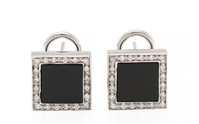 A pair of onyx and diamond ear pendants each set with a polished onyx encircled by numerous brilliant-cut diamonds, mounted in 18k white gold. (2)