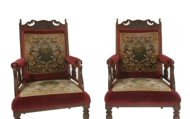 A pair of red velvet covered armchairs