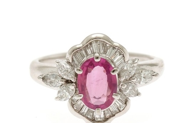 A ruby and diamond ring set with an oval-cut ruby, app. 0.95 ct. and numerous diamonds totalling app. 0.57 ct., mounted in platinum. Size 53.