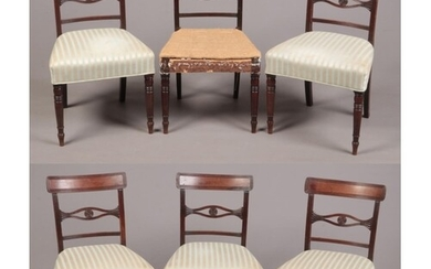 A set of six Regency mahogany dining chairs. With reeded cre...
