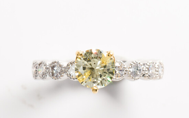 A yellow and colorless diamond fourteen karat white gold ring