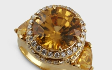 A yellow zircon, diamond, and eighteen karat gold ring