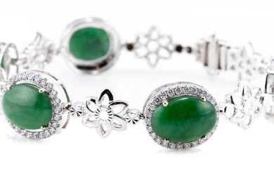 AN 18CT WHITE GOLD JADE AND DIAMOND BRACELET; composed of 6 oval cluster each centring an approx. 13 x 9mm green cabochon jade surro...