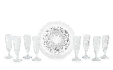 ATTRIBUTED TO BACCARAT, A SET OF EIGHT HOBNAIL CUT CHAMPAGNE...