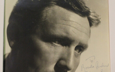 AUTOGRAPH. A black and white photograph of Spencer Tracey, signed, dedicated and dated 'Jan 193
