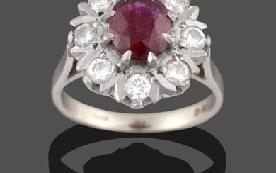An 18 Carat White Gold Ruby and Diamond Cluster Ring,...