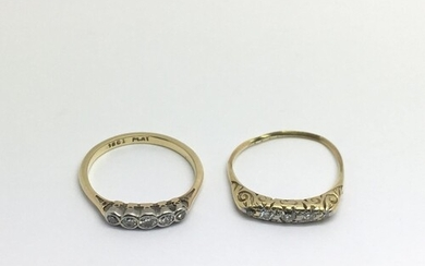 An 18ct gold and platinum ring set with dive small diamonds ...