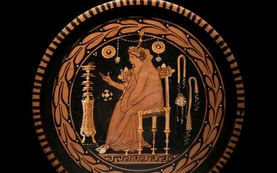 An Apulian Red-Figured Plate with a Seated Goddess or