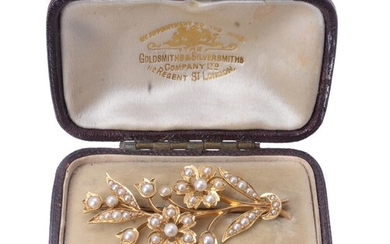 An Edwardian half pearl floral spray brooch