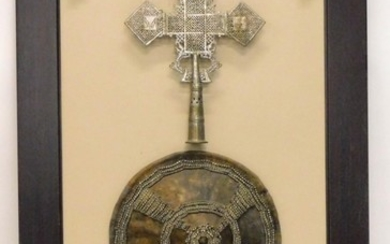 An Ethiopian shield, embellished in silver coloured metal wi...