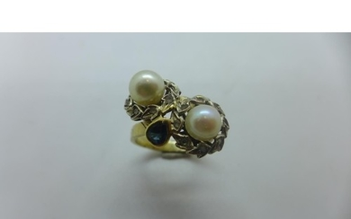 An unmarked yellow gold pearl ring, size O, approx 7 grams, ...