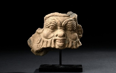 Fragmentary relief representing the mask of the god Bes.