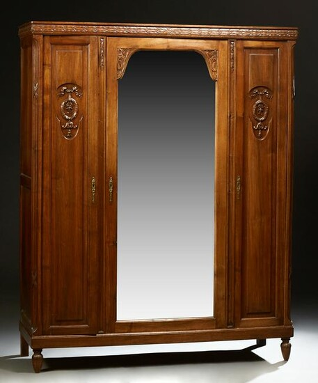 French Louis XVI Style Carved Walnut Armoire, c. 1900