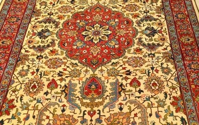 Large and rather thin Tabriz ( North West of Iran ). Middle XX°. Technical characteristics velvet made of quality lambswool on a cotton foundation. Beautiful polychromy. Beige field with garlands of geometrically multicoloured stylised palmette...