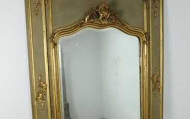 Overmantel mirror in grey-green lacquered wood and gilded stucco.