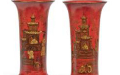 ƒ PAIR OF 19th CENTURY PORCELAIN CORNER VASES Overdecorated in black and gold with pagodas and sinister figures, on a coral background H.: 33 cm. (13 in.) - (USD 1,768 - USD 2,946)