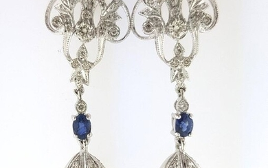 Pair of 750°/°°° white gold leafed earrings set with diamonds holding in pendants a sapphire adorned with a cultured pearl, L 4cm, Gross weight: 9g