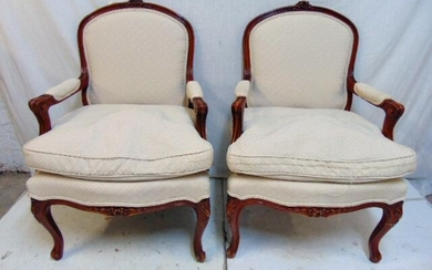 Pair upholstered bergere armchairs, carved wood frames