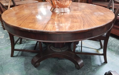 Regency Rosewood Tilt Top Supper Table, the round top on a turned pedestal with reeded collar & quadraform base