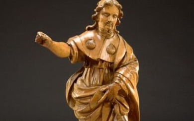 Saint Roch and his dog, a large sculpture in natural wood, the Saint is covered with a long mantle decorated with shells.