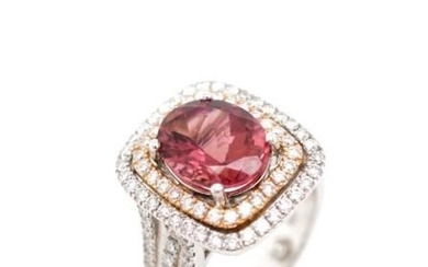 Tourmaline and diamond set 18ct gold halo ring by Hardy Bros...