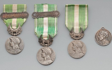 "Three medals of the campaign of Morocco (1909) in silver, with their ribbon, of which two with bars: ""HAUT GUIR""; diameter 30 mm, weight 21 g. One medal by Auguste Maillard, 1916, in silver metal, marked: ""PARIS 1914/1916 - JUSQU'AU BOUT"", signed:..."