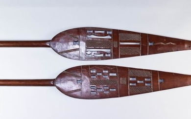 Two African Hardwood Paddles, 20th Century, the blades with...