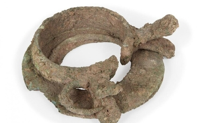 Two Chinese bronze bracelets, Neolithic period, now fused as one,...
