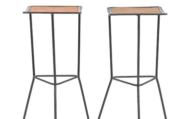 Unknown design: A pair of three-legged bar stools with black lacquered metal frame, seat with bamboo. H. 77. (2)