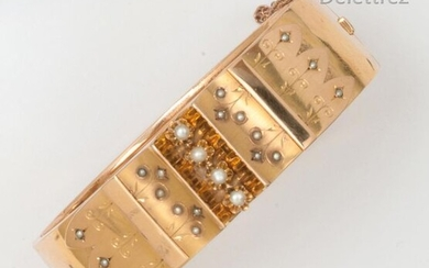 """Yellow gold """"Opening rush"""" bracelet, decorated with a central motif of arabesques set with pearls. Inside length: 16.5cm. Gross weight: 25.6g."""