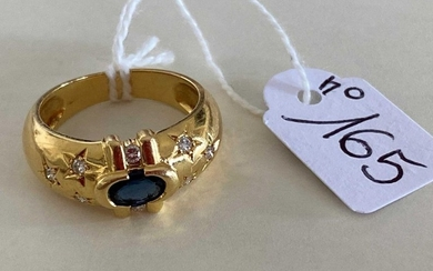Yellow gold ring set with a sapphire in...