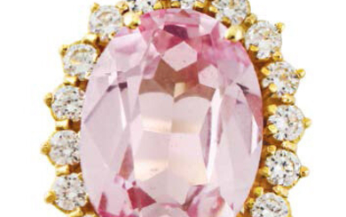 Yellow gold ring with oval pink synthetic gemstone...