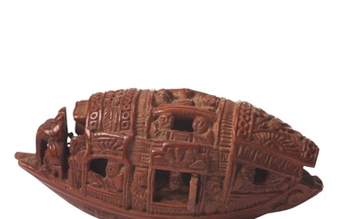 A Chinese nut boat sculpture, with poem.