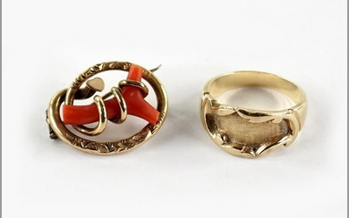 A Coral and 14 Karat Yellow Gold Brooch.