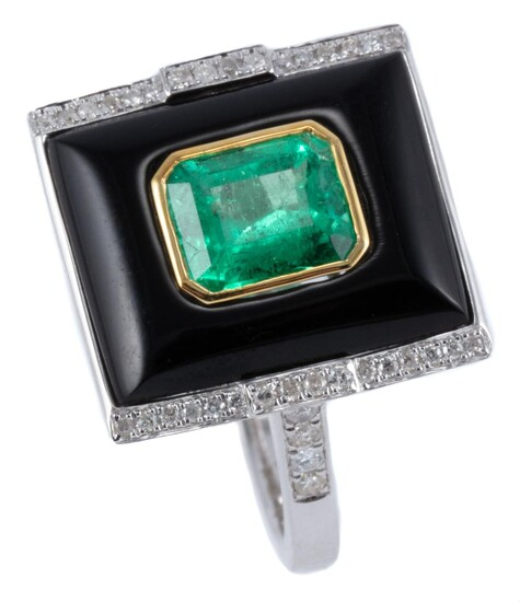 A DECO INSPIRED EMERALD DIAMOND AND ONYX RING; rectangular cabochon onyx centre bezel set in yellow gold with an emerald cut emerald...