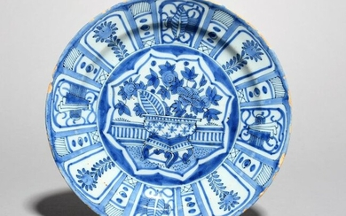 A Delft plate late 17th century, painted in...