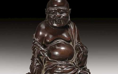 A FINELY CARVED WOOD SCULPTURE OF BUDAI.