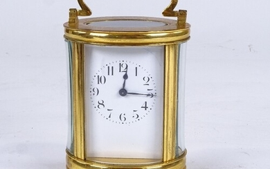 A French oval brass-cased carriage clock timepiece, white en...