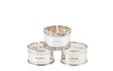 A MODERN PAIR OF SILVER NAPKIN RINGS, with open pierced deco...