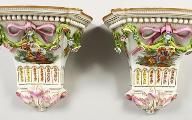 A PAIR OF SEVRES STYLE PORCELAIN WALL BRACKETS painted