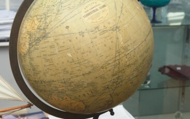 A PHILIPS 18 INCH NEW COMMERCIAL TERRESTRIAL GLOBE ON A CAST IRON BASE, 64 CM HIGH, LEONARD JOEL LOCAL DELIVERY SIZE: MEDIUM