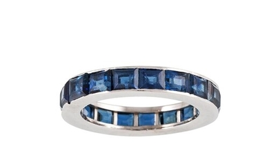 A SAPPHIRE FULL ETERNITY RING, channel set with princess cut...