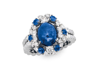 A Sapphire, Diamond and Blackened White Gold Ring