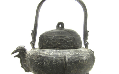 A bronze zoomorphic wine vessel and cover