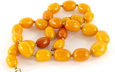 A butterscotch amber bead necklace.